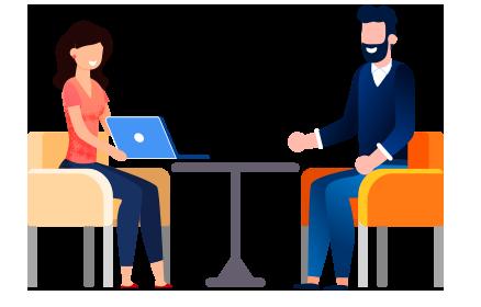Deux personnes assises autour d'une table